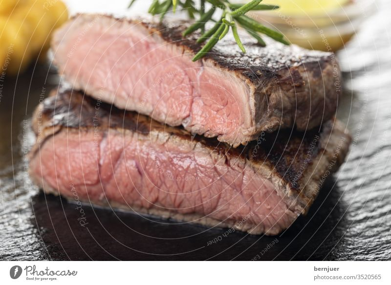 Slices of grilled steak on black slate Gourmet Frying medium Meat Meal Dinner boil Barbecue (apparatus) Beef Pepper Fresh Delicious sirloin roasted tenderloin