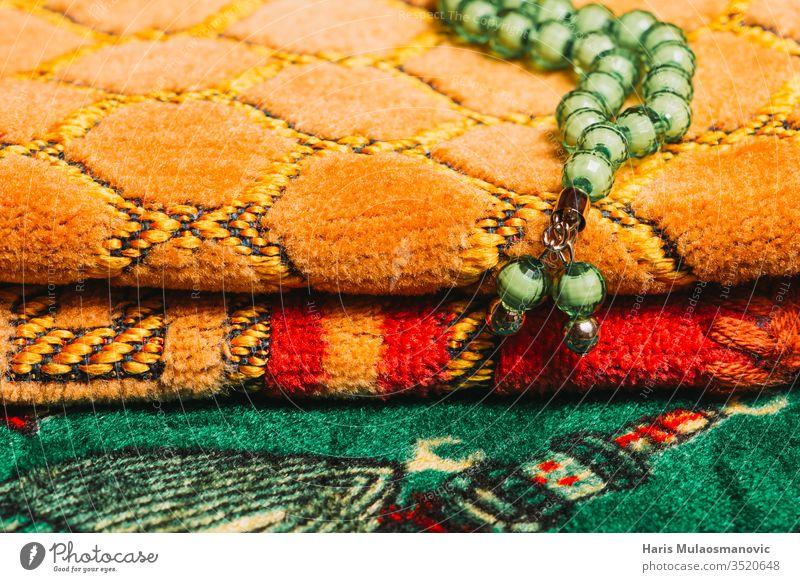 Green praying beads Islamic prayer mat textures close up addiction ambient anti tobacco ash ashtray background bad habit bad habits beverage black