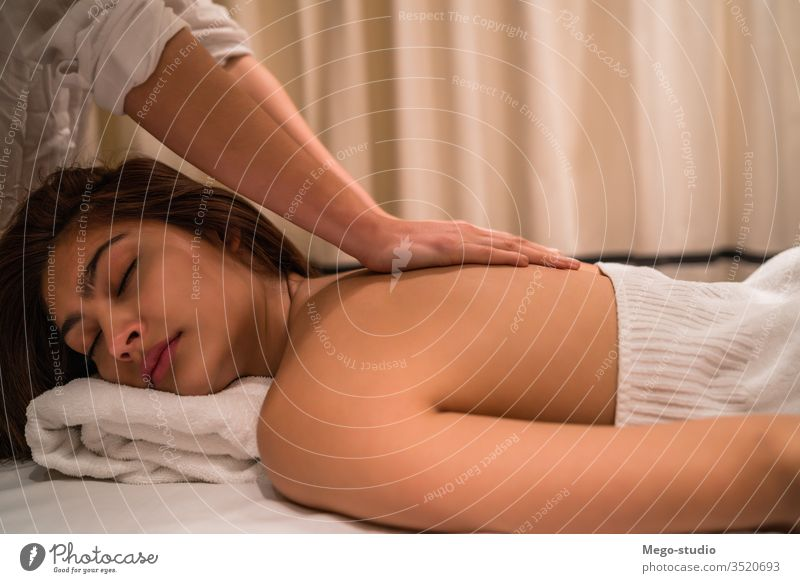 Young woman relaxing in the spa. massage therapy treatment female one healthcare hand comfortable dayspa resting closed pleasure purity traditional procedure