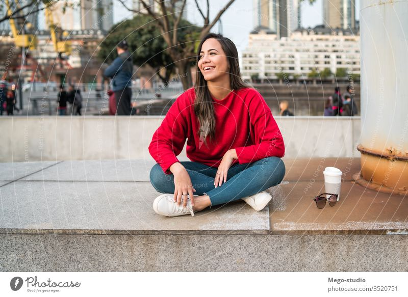 Portrait of young latin woman. people girl adult street female urban casual fashion coffee person city cute style pretty beauty modern happy one model beautiful