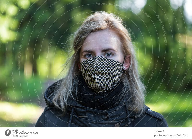 woman outside with wool mask on her face face mask wool face mask protection covid-19 wool mask protection woman mith mask woman with wool mask 2019-ncov