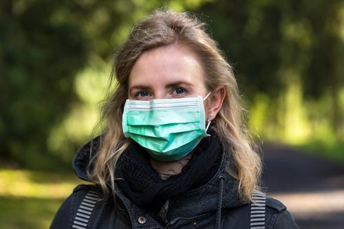 woman with an operation face mask on outdoors protection covid-19 mask protection woman mith mask woman with an operation mask 2019-ncov coranvirus Wuhan