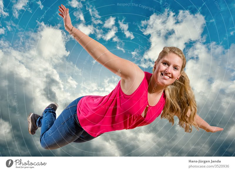 Young girl flies laughing high in the clouds Woman Sky Jump joyfully youthful Blue Summer fun Happiness Joy Freedom People Child outside Energy active person
