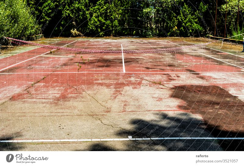 Grunge abandoned tennis court field sport game leisure nobody old view background green net wild plant grass tree vegetation empty bush play activity fence