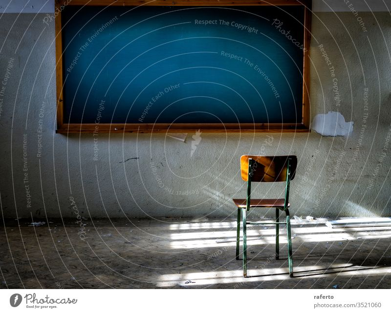 Abandoned classroom with chair in front of the vintage blackboard blank abandon abandoned office grunge interior broken down old dilapidated exploration urban