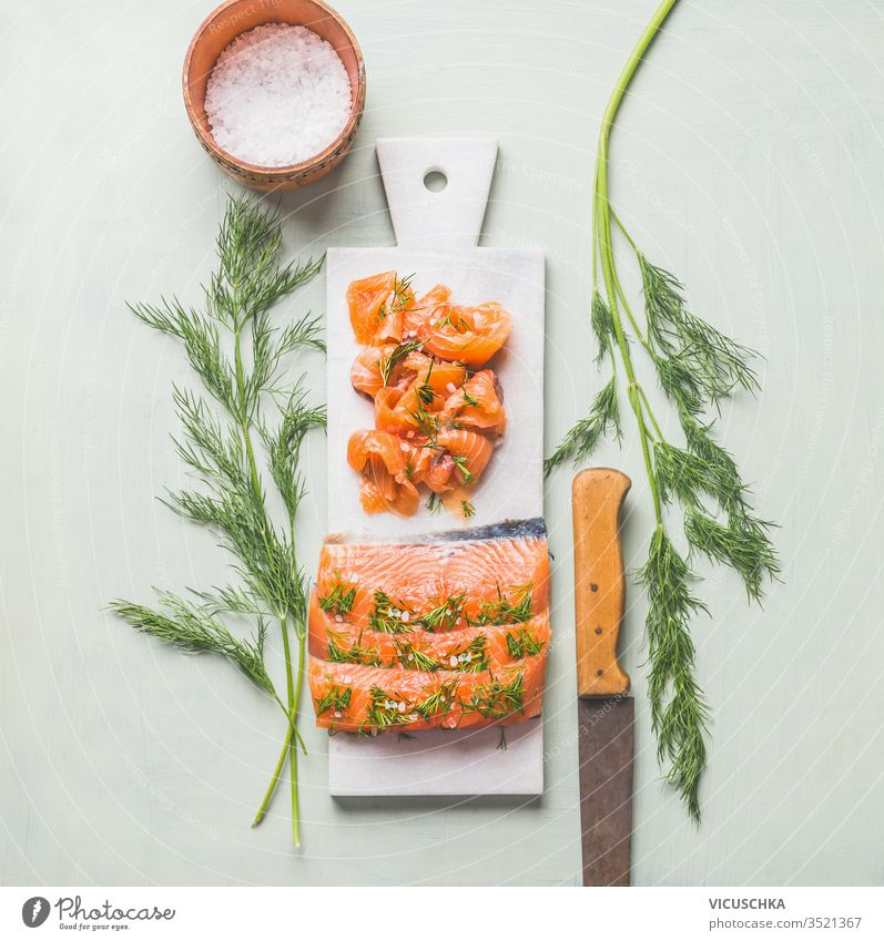 Homemade smoked salmon fillet with dill and lemon served on marble cutting board homemade light background top view healthy food tasty cuisine norwegian