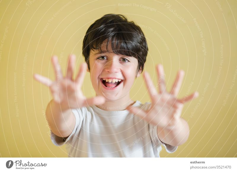 happy kid spreading hands up,background blur child spreading up showing smiling joy sign euphoria euphoric scream cheerful energy excited fun funny expression