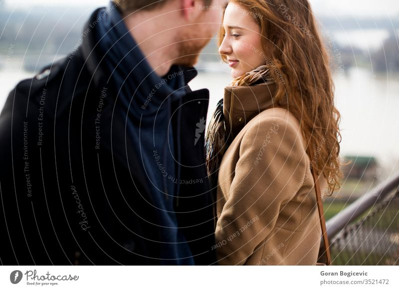 Young loving couple outdoor love guy two redhead park autumn day life adult casual people female beard jacket girl face men winter fall outdoors hair romance