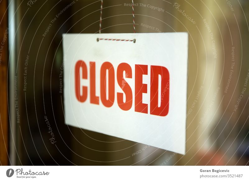 Closed sign board hanging on door of cafe or small store business window shop white street red sorry vintage closed text glass showroom reflections urban signal