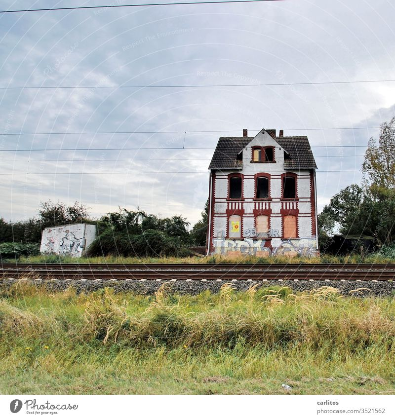 """The old house at the railway embankment had seen a lot. Especially """"Better Times"""" House (Residential Structure) Old Ruin Railroad tracks Window nailed"""