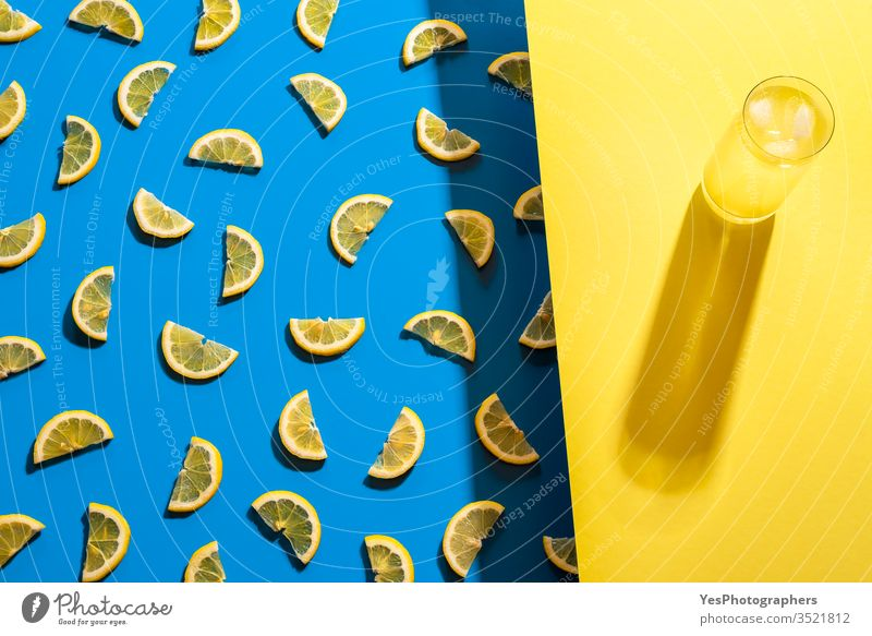 Glass of lemonade and lemon slices pattern. Summer cold drink aligned beverage bicolor blue citrus fruits cocktail colorful concentrate delicious detox duotone