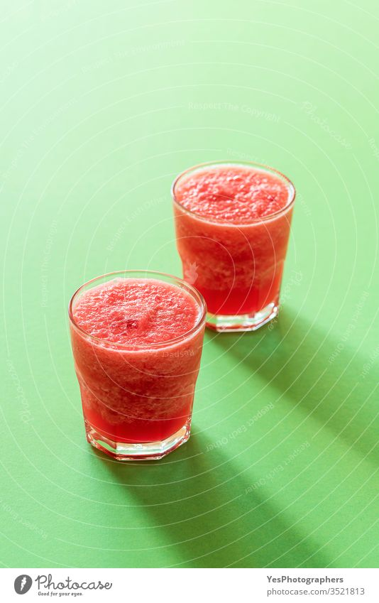 Glass of watermelon drink. Two portions of slush. Cold beverage breakfast cold drink colorful delicious dessert detox diet fresh freshness frosty frozen