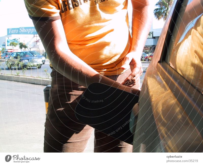 Man Hand Sun Yellow Car Petrol station Refuel