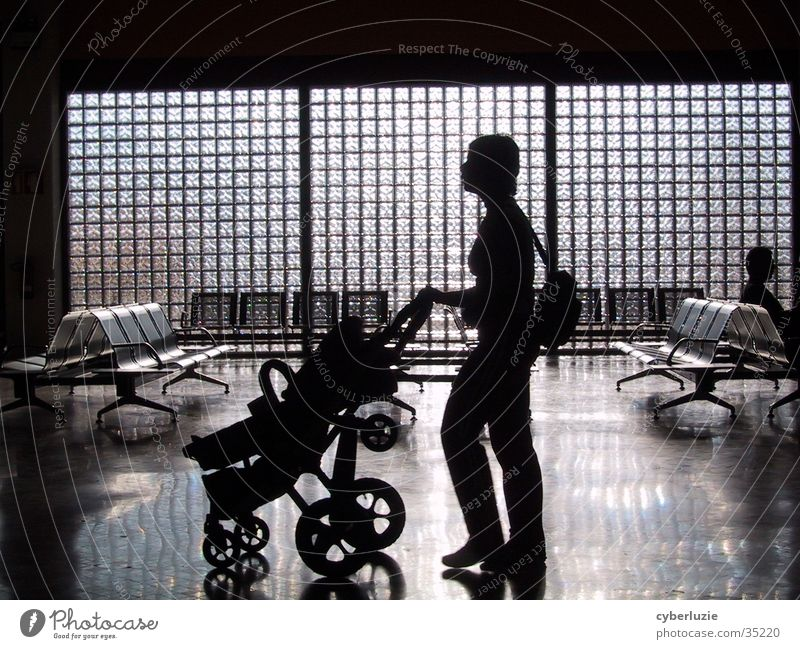 Airport Faro Part II Woman Baby carriage Chair Silhouette Glass