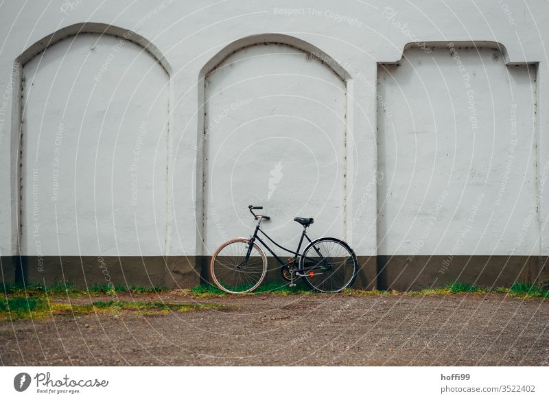 old bike on the wall Bicycle Old old bicycle Wall (building) Parking of bicycles switch off Wall (barrier) Transport Cycling Means of transport