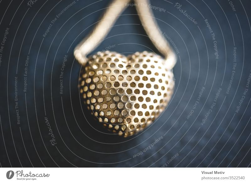 Metal mesh heart in a necklace accessory art and craft art work beautiful close up close-up closeup decoration design elegance fashion gift heart shape indoor