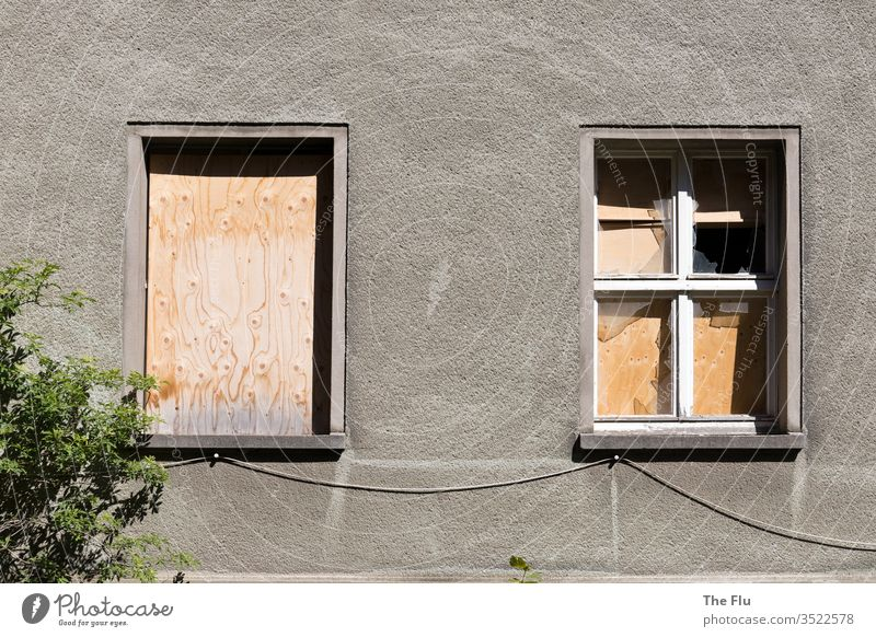 Nailed up house front House (Residential Structure) Ruin Window Deserted Decline Old Broken Wall (building) built Facade Exterior shot Past Subdued colour