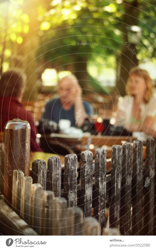Soon the beer gardens will open again Beer garden Gastronomy persons people Beautiful weather sunny Wooden fence Together
