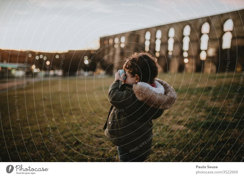 Child taking picture on sunset Camera taking photo Photography Technology Sunset Caucasian childhood Exterior shot Vacation & Travel Lifestyle Tourist Happiness
