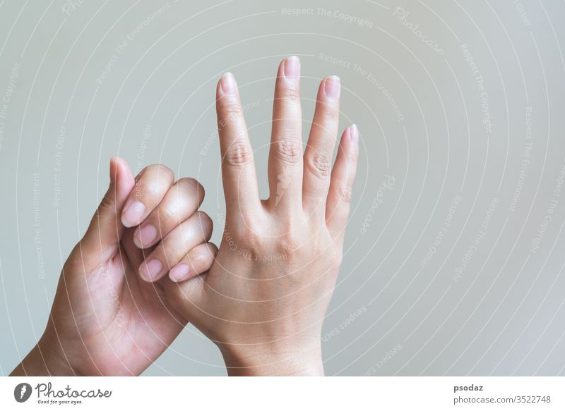 Woman massaging her painful hand. Healthcare and medical concept. ache adult arm arthritis background body carpal caucasian closeup cold cramp disease exercise
