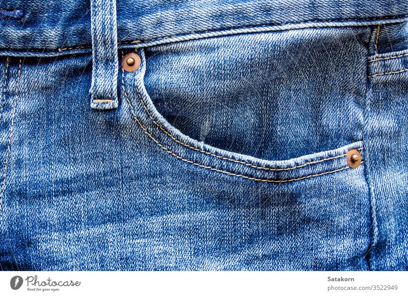 Pocket of denim blue jean jeans pocket textile pants casual fabric pattern background close up clothing garment old detail color closeup fashion object trousers