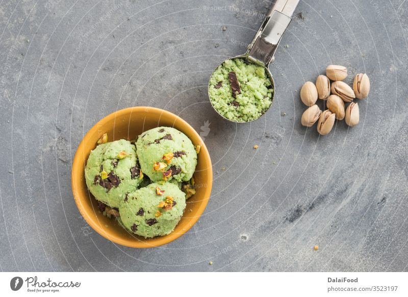Ice cream with pistachio and chocolate background ball bowl cold creamy dairy decorated delicious dessert flavor food frozen fruit green homemade ice ice cream