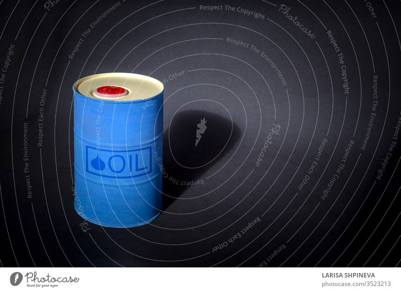 """Metal barrel of oil with text """"oil"""" on black background. Concept of oil market production, global financial crisis. gasoline industry metal pollution isolated"""