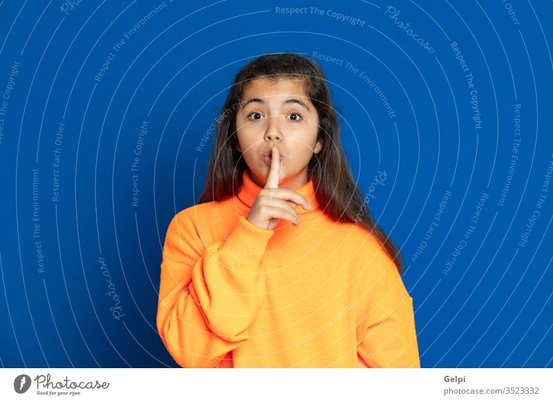 Preteen girl with yellow jersey preteen blue mute cover mouth silence unhappy forbid shy female people person pretty attractive background teenager cute