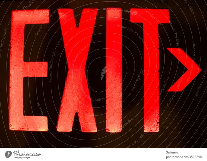 exit sign Way out Direction Road marking Highway ramp (exit) English ring illuminated sign Light Emergency exit Signs and labeling Colour photo Escape route