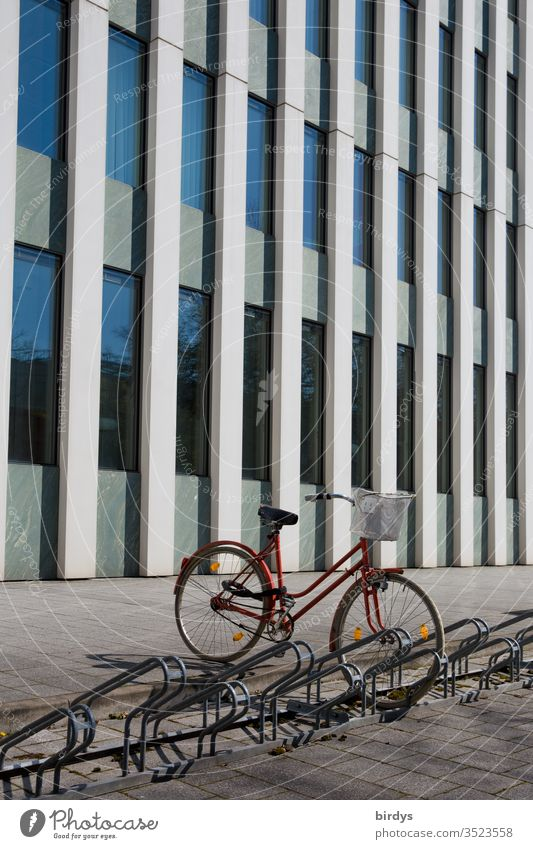 Parked bicycle in front of modern office building Bicycle Ladies bike Bicycle rack Office building Facade Modern Deserted Exterior shot Window Colour photo