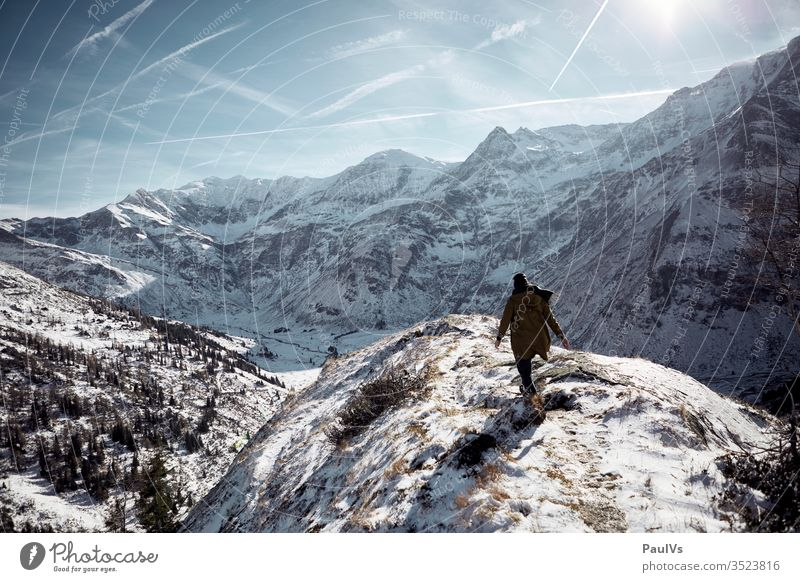 Man hikes in winter on the mountain in the Alps Tauern high tauern Bad Gastein Bad Hofgastein sports guest stone Salzburger Land Economy onset of winter Hiking