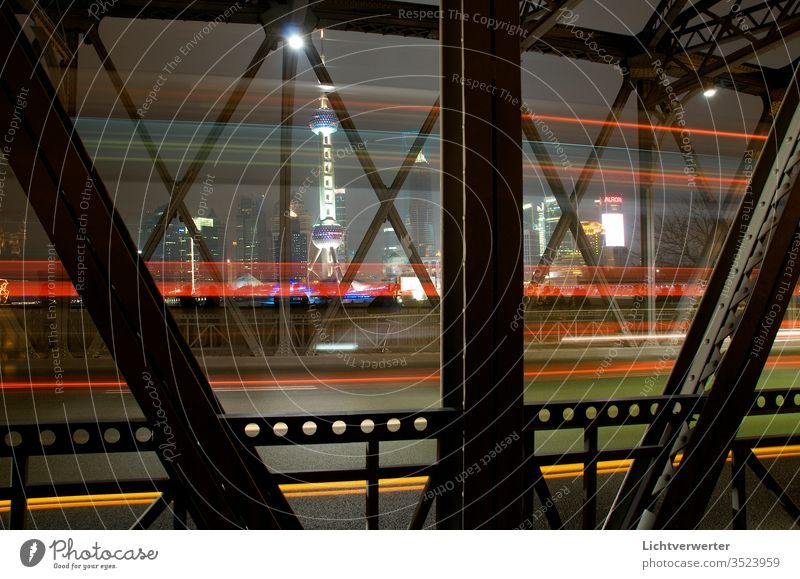 View through the Waibaidu Bridge to Pudong Shanghai. With Pearl Tower. Some vehicles crossed the road pearl pearltower pudong Light light movement Long exposure