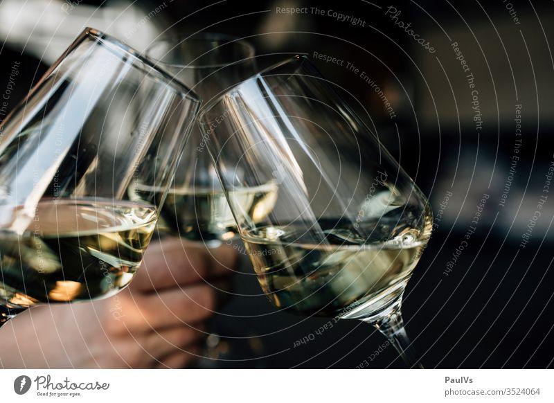 wine glasses / toasting / cheers / 3 white wine glasses White wine Chardonnay Party Toast celebrations Glazier green veltliner Austrian wine Südsteiermark