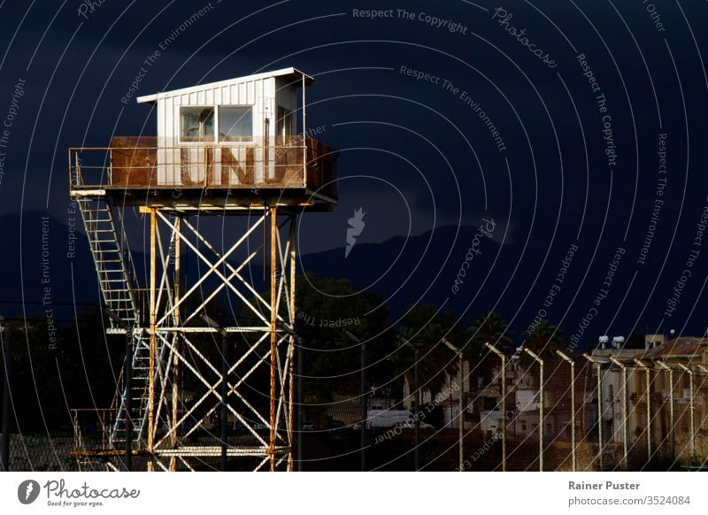 "14 Feb 2020 - Nicosia, Cyprus: United Nations guard tower at the border zone ""Green Line"" in Nicosia, Cyprus barbed wire barrier closed closeup concept conflict"