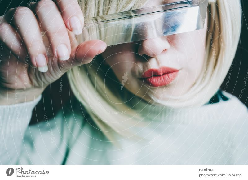 Close up of a young woman's face covering by a prism art close up glass crystal distortion reflection lips blond blonde mouth cold clean silence secret timidity