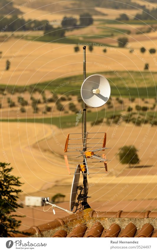 Parabolic Repeater Antenna And Terrestrial Television Antenna On A Roof. science signal engineering broadcast broadcasting telecommunications astronomy european
