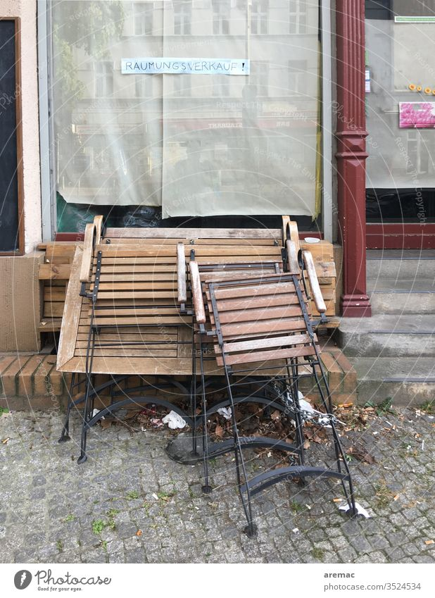 Shop window with sign clearance sale and tables and chairs Sale Chair Table Closed Deserted Exterior shot broke built Window Store premises Colour photo