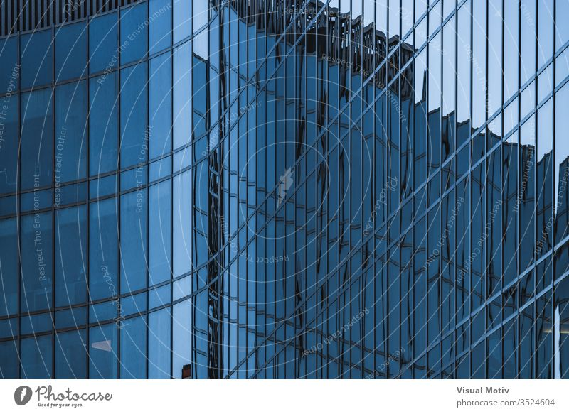 Glass wavy facade of an office building windows architecture architectural architectonic urban metropolitan constructed edifice structure geometric geometrical