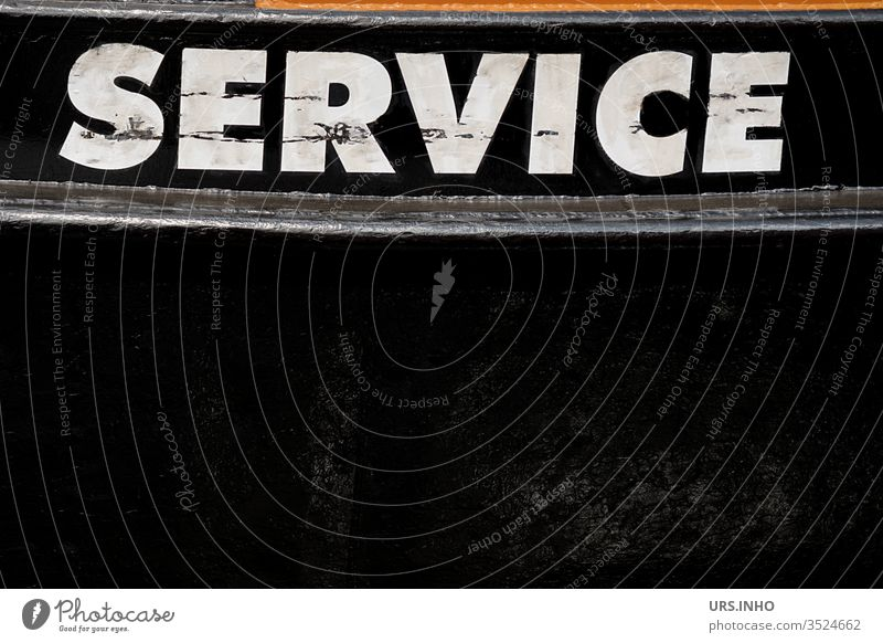 white lettering SERVICE in capital letters on black background service Text Inscription Schriftzechen Black White Hull boat schmutziz Letters (alphabet)