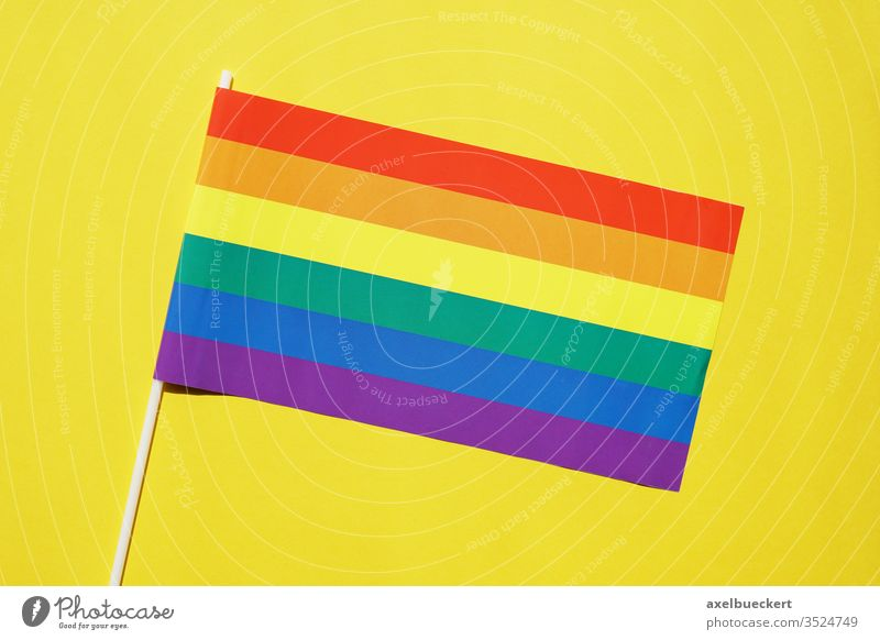 rainbow flag gay or lgbt pride symbol on yellow background diversity lgbtq queer gay pride homosexual lesbian bisexual transgender movement community sexuality