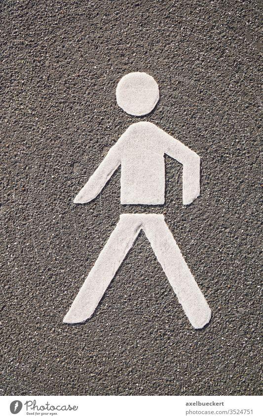 Pedestrian pictogram symbol road marking pedestrian asphalt footpath street walk walking crossing sign icon traffic white human representation figure paint