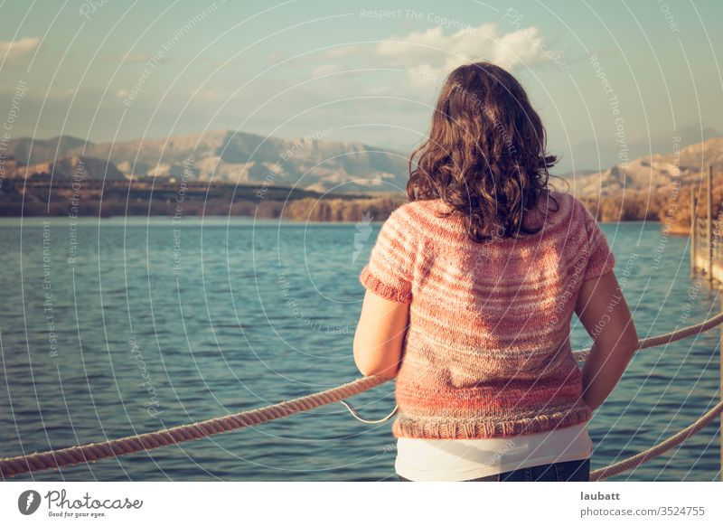 Woman staring at the lake side, back portrait of a woman looking to the horizon at the dock Lake Lakeside Day Exterior shot Nature Landscape Water Reflection