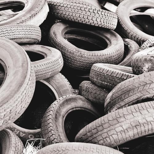 a bunch of old car tires Car tire Tire Old Broken Rubber tires Special waste Trash Dispose of Environmental pollution Tire tread wild landfill Heap Disposed of