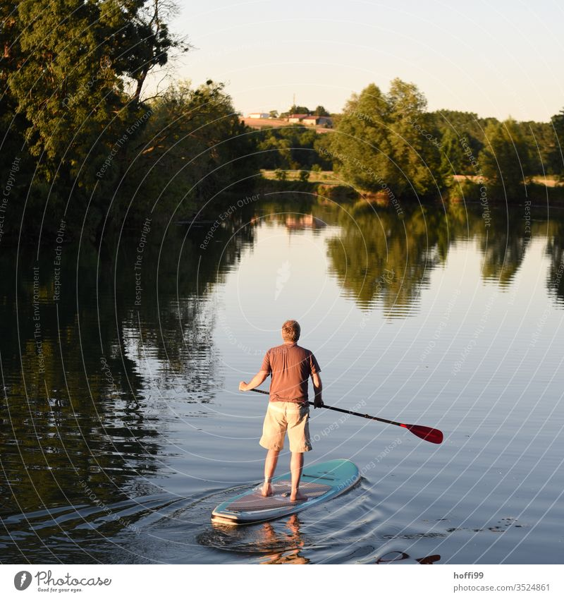 StandUp paddler with injured foot on calm water - vacation stand-up paddling SEA Human being Aquatics Summer Nature Sky Fitness Vacation & Travel Water