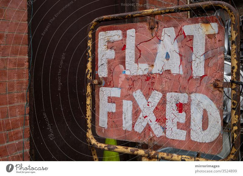 Distressed old fix a flat tire red and white sign old weathered flat fixed sign distressed old design illustration typography poster banner symbol card