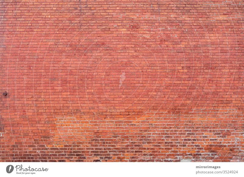 Distant building red brick wall surface body background full wall distant brick wall masonry textured space exterior construction design style orange brown