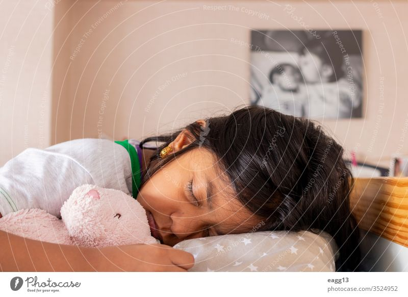 Little girl sleeping on her bed inside her room adorable asleep bear bedding bedroom bedtime brown hair calm care comfort comfortable dream dreaming eyes closed