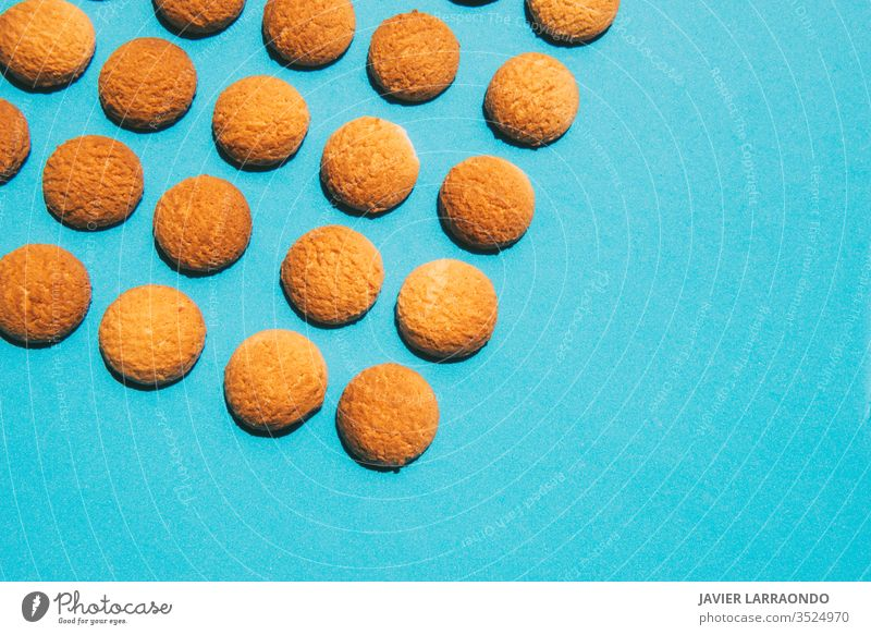 Tasty butter homemade cookies on a blue background.Homemade sweets concepts candy gold macro sweet food baked pastry copy space baking sugar tasty ingredient