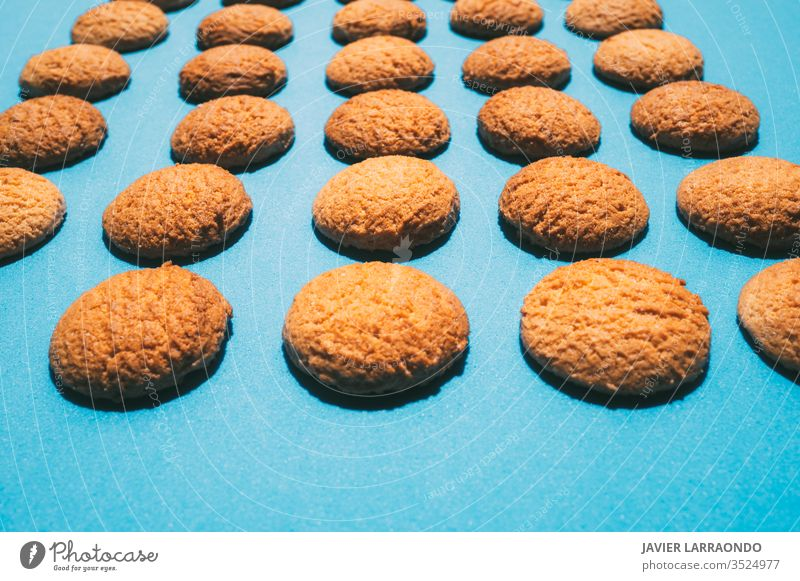 Tasty butter homemade cookies on a blue background.Sweet food concepts backgrounds bake baker biscuit breakfast candy closeup color image copy space crunchy