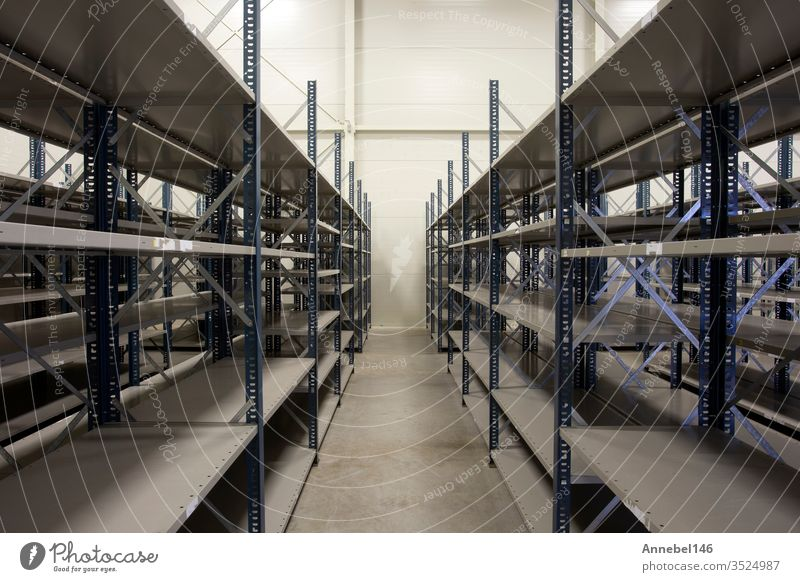 huge warehouse with empty racks inside for storage modern design, metal shelves for distribution storehouse industry business shelf new industrial interior